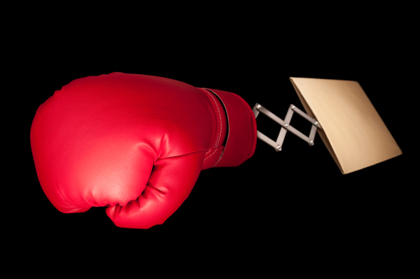 Red boxing glove emerges from manilla envelope